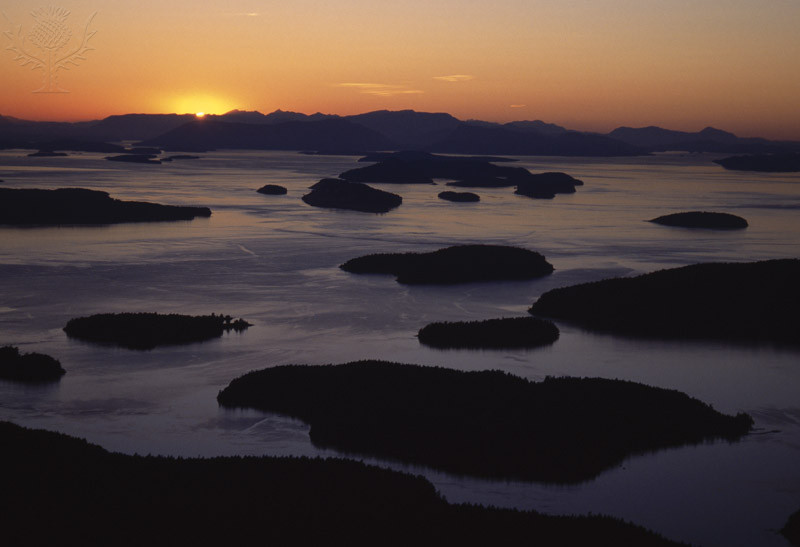 SAN JUAN ISLANDS at dusk Wasp Islands, aerial view Sun setting ovr Vancouver Island Washington, USA