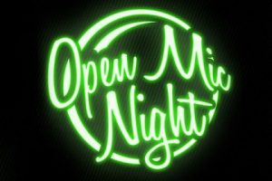 neon sign saying open mic night
